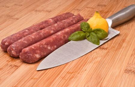 italian sausage: raw italian sausage on wooden board