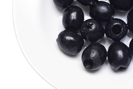 pitted: Black pitted olives isolated on white