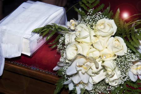 Beautiful white wedding bouquets and Bible photo