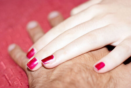 hands of boyfriends in love on red background Stock Photo