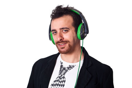 portrait of young man with green headphones listening to music on a white background photo