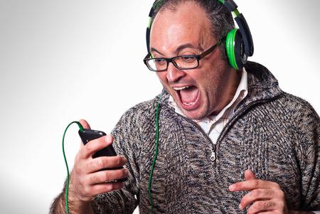 Man listen music on headphones and scream aloud  Music mobile concept