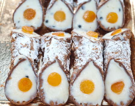 annealed: Sicilian cannoli with orange typical sicilian sweet  closeup