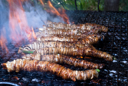 bowels: Stigghiole -typical street food in Palermo  lamb, goat or pork bowels flavored with onions and parsley and grilled over coals Stock Photo