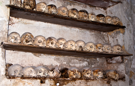 atrocity: PALERMO - ITALY, JUNE 09, 2014: Catacombs of the Capuchins are burial catacombs in Palermo. Today they provide a somewhat macabre tourist attraction