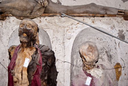 catacomb: PALERMO - ITALY, JUNE 09, 2014: Catacombs of the Capuchins are burial catacombs in Palermo. Today they provide a somewhat macabre tourist attraction