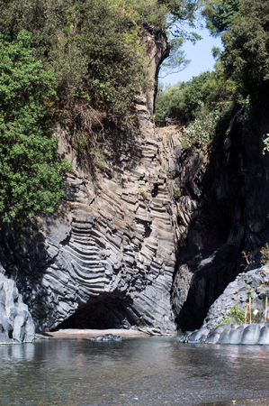 Gole dellAlcantara - a canyon on the river Alcantara, which goes through the lava stones of Mount Etna in Sicily, Italy photo