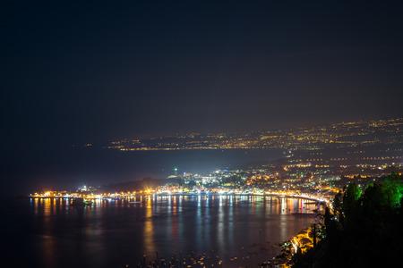 vulcano: Night view from Taormina with Etna volcano Stock Photo