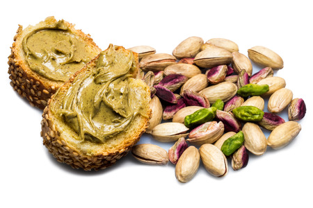 munch: Bread with pistachio cream isolated on a white background