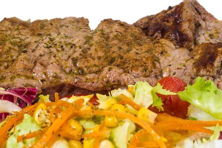 tenderloin: slice tenderloin with salad. Closeup Stock Photo
