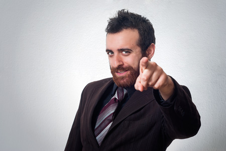 attractive businessman pointing a finger towards you