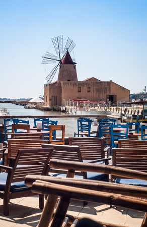 bar with a view of the harbor of Marsala to the island of mozia. Sicily, Italy