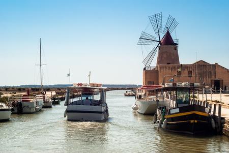 Mozia salt flats and an old windmill.Italy, Sicily, Marsala (Trapani)
