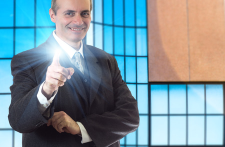 Portrait of a happy senior business man smiling Stock Photo