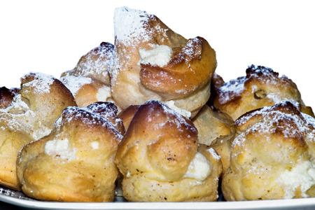 bigne: Bigne filled with ricotta cream isolated on white Stock Photo