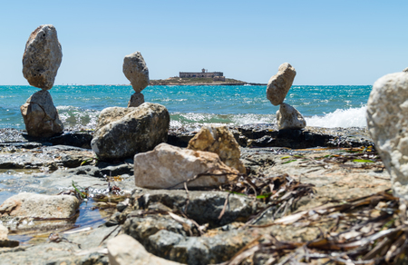 currents: Balanced stones near island of currents in Sicily. Italy Stock Photo