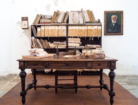 anthropological: PALERMO, - ITALY-  JULY 11: antique desk and library of Giuseppe Pitre in Palermos Museo Antropologico Etnografico Siciliano on July 11, 2015. Museum was founded in his memory