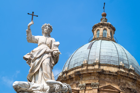 santa rosalia: Statue of Santa Rosalia next to the cathedral of Palermo.The Saint is shown standing in the act of trampling a female figure slumped at his feet representing the plague. Sicily, Italy Stock Photo