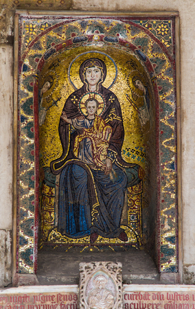 Byzantine mosaic of Madonna and Child (13th century) above the main entrance along the flank of the Cathedral of Palermo,Sicily
