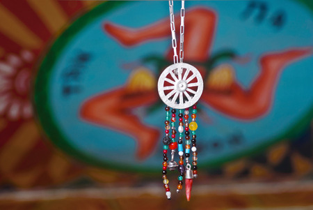 handcrafted: collection of handcrafted jewelry inspired by the Sicilian cart.jewelry made from roberto Intorre