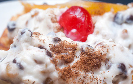 st lucia: Cuccia is typical Sicilian sweet, made from boiled wheat and ricotta cream. It is garnished with pumpkin, cinnamon and chocolate chips, and is traditionally prepared and consumed on the feast of Saint Lucia on December 13. Selective focus