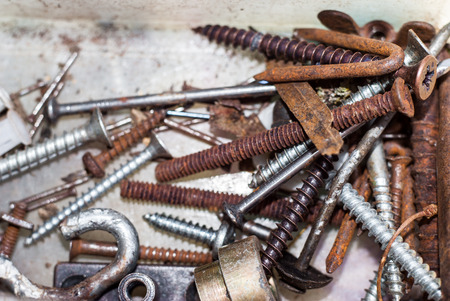 worm gear: Background with different vintage mechanical components, gears, nails; screws, industrial objects Stock Photo
