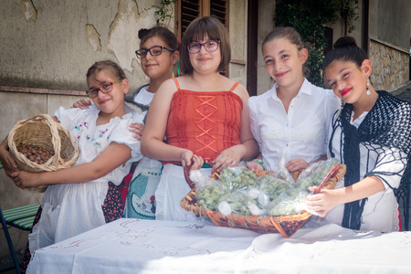 undefined: POLIZZI GENEROSA, SICILY-AUGUST 09 2015 :childrens undefined from sicilian folk group at the International Festival of hazelnuts in Polizzi Generosa,Sicily, Italy