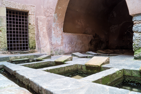 washhouse: Picturesque cluster of 16th-century wash basins in Cefalu, Sicily, Italy