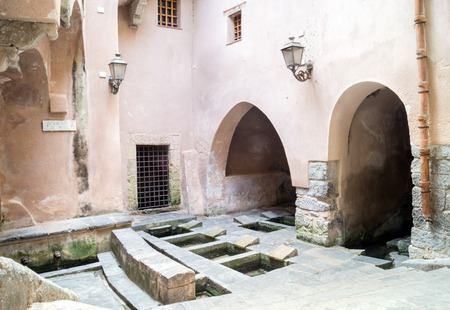 basins: Picturesque cluster of 16th-century wash basins in Cefalu, Sicily, Italy