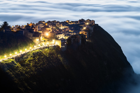 A particularly attractive view of the Sicilian town, Polizzi Generosa when low cloud (the so-called maretta) collects around the foot of the mountains
