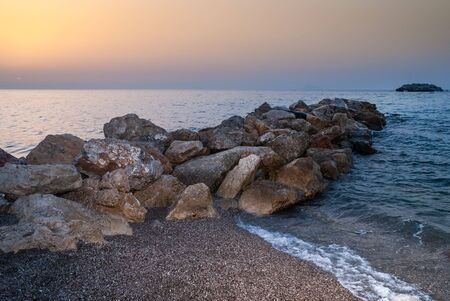 alicudi: Brolo beach at sunset. Sicily, Italy