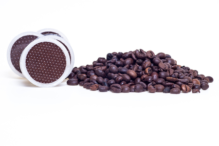 capsules coffee and coffee beans isolated in white background