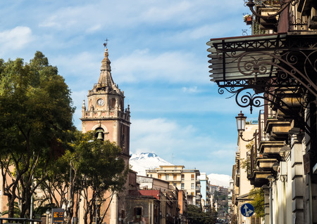 Beautiful view of Via Etnea in Catania with Etna volcano