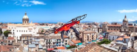 Red drone flying over the city. Palermo, Sicily, Italy