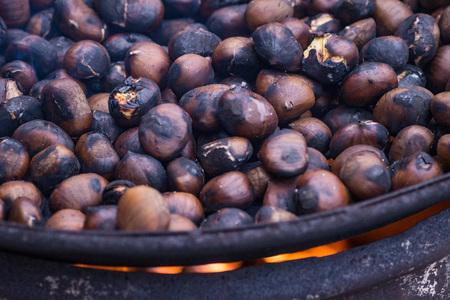 Roasting chestnut in fry, closeup
