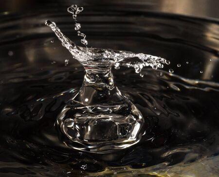 water drop splash in the shape of water pitcher.closeup