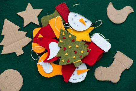 Making of handmade christmas toys from felt. Christmas card. Archivio Fotografico