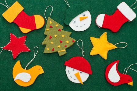 Making of handmade christmas toys from felt. Christmas card.