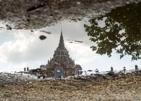 dome of the chapel of the Holy Shroud of Turin reflected on a puddle, Torino, Italy