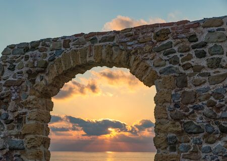 Arch overlooking the sky at sunset in Cefalù, Sicily, Italy