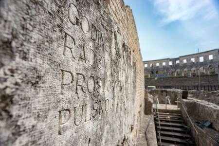 Ancient Roman Amphitheater in Pula, Croatia. Famous tourist destination