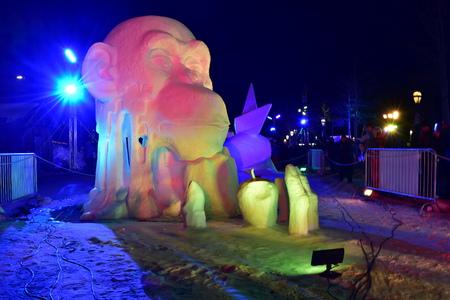 Breckenridge, Colorado, USA: Jan 28, 2018: Colourful Night Snow Sculpture Team China: Thinker