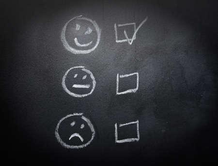 checkboxes: Smiley or Sad Checkboxes on Blackboard Stock Photo