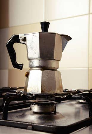 retro styled imagery: Italian vintage coffeepot on kitchen stove