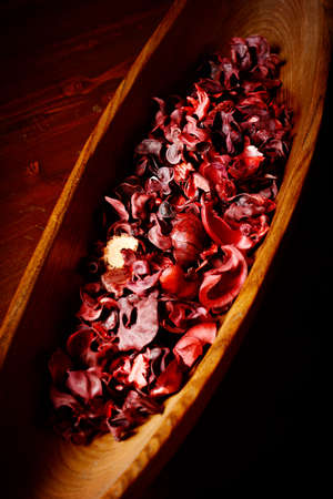 potpourri: bowl of potpourri  on dark wooden table Stock Photo