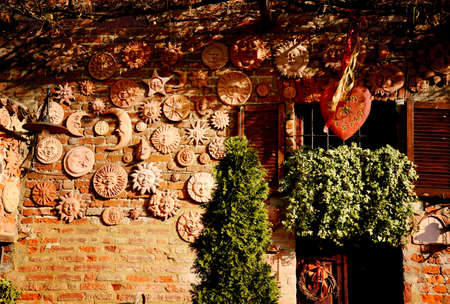 handmade collection of terracotta sun decoration