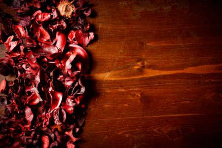 potpourri: red scented potpourri  on dark wooden table Stock Photo