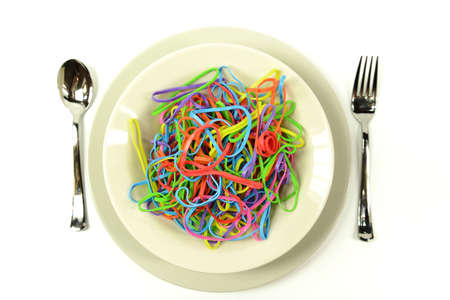 rubber bands: plate of spaghetti made of  rubber bands Stock Photo