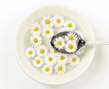 purify: ceramic bowl with daisy flowers and spoon