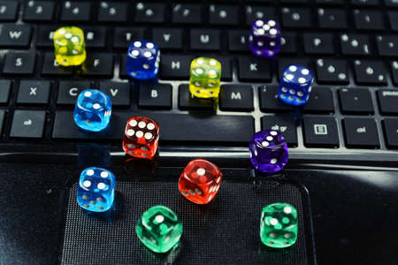 gambling: colored  dices on keyboard - on line gambling concept